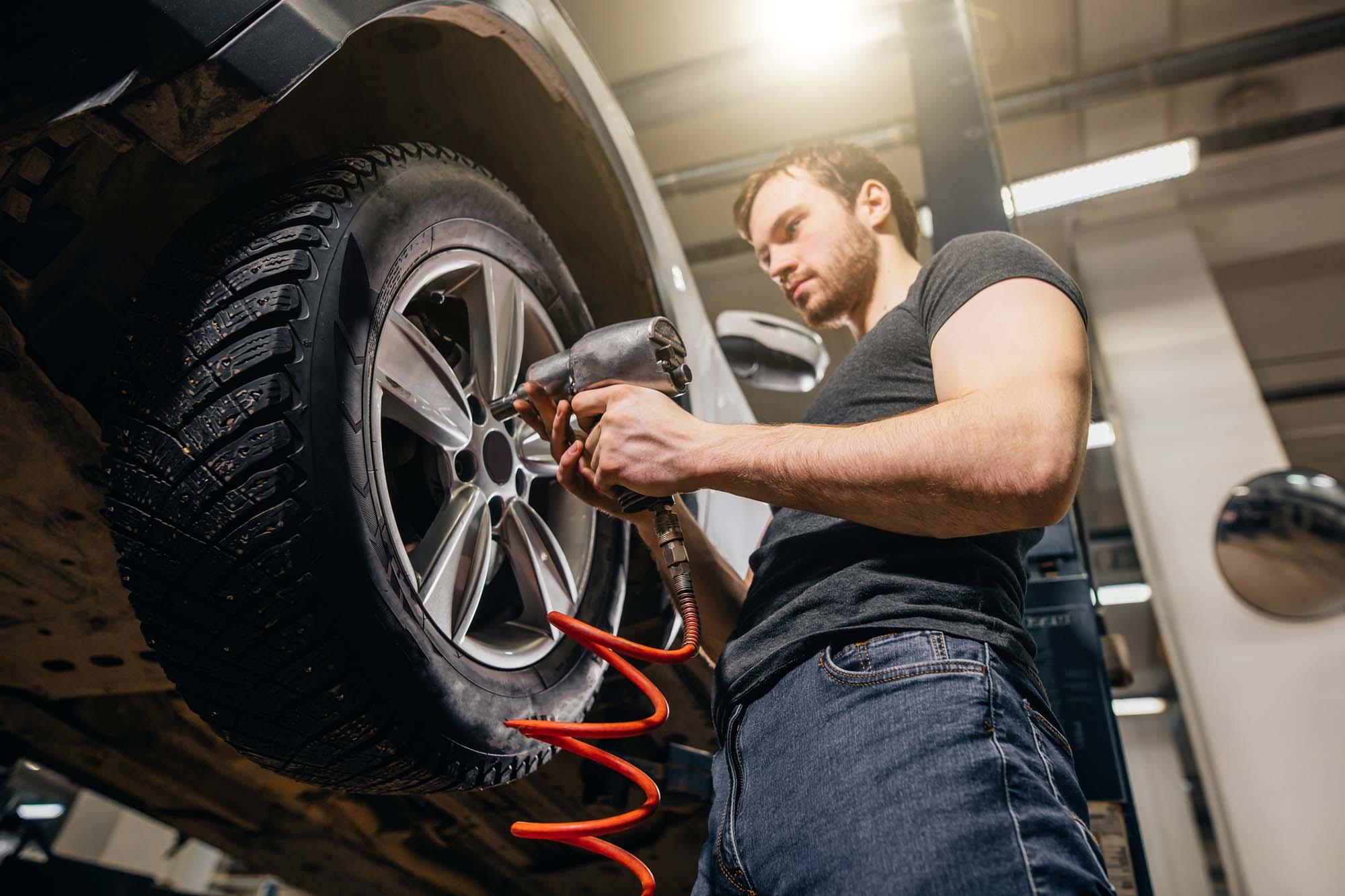 Man replacing tyre